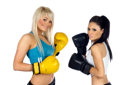 Young women stood wearing boxing gloves isolated on a white background photo