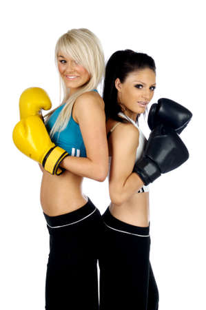 Young women stood back to back wearing boxing gloves isolated on a white background photo