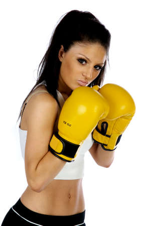 Young brunette woman with yellow boxing gloves on isolated on a white background photo