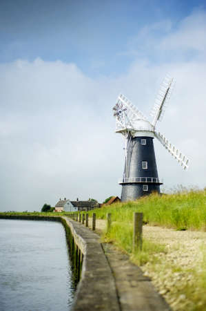 Norfolk Broads black and white windmill on a summer day Stock Photo