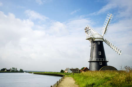 Norfolk Broads black and white windmill on a summer day landscape Stock Photo