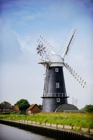 Norfolk Broads black and white windmill on a summer day Standard-Bild