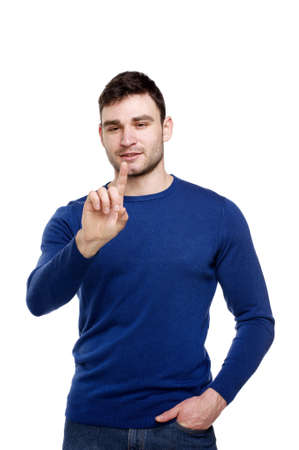 Man dressed casually pointing forwards isolated on a white background  Stock Photo - 18495041