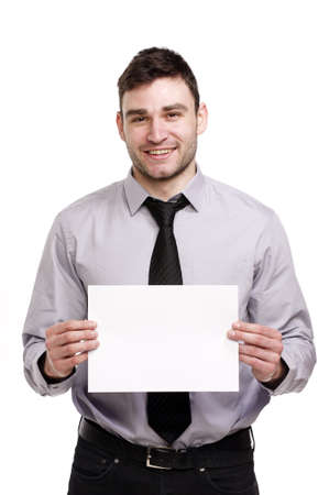 Handsome business man isolated on a white background smiling holding a blank sign Stock Photo - 18495223