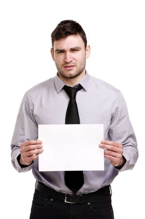 Handsome business man isolated on a white background looking confused holding a blank sign Stock Photo - 18495219