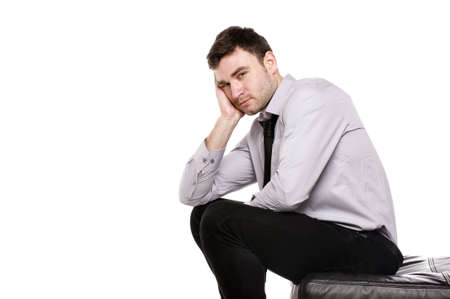 Business man stressed sat with his head in his hands isolated on a white background Stock Photo - 18495238