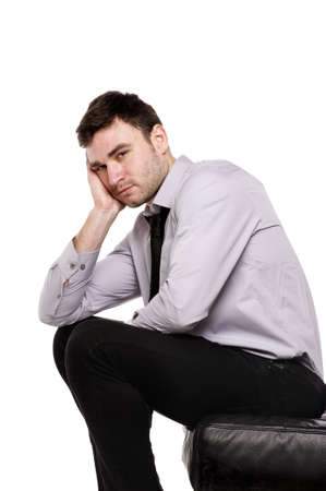 Business man stressed sat with his head on his hand isolated on a white background Stock Photo - 18495232