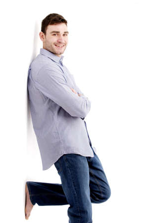 casually: Casually dressed handsome man leaning isolated on a white background Stock Photo