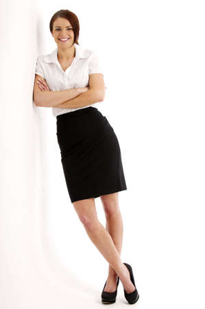 Beautiful brunette business woman isolated on a white background