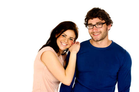 Cute dark haired couple stood together smiling at the camera isolated on a white background photo
