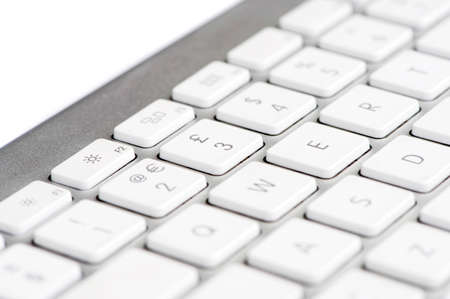 Apple mac white Keyboard focused on the number 3 photo