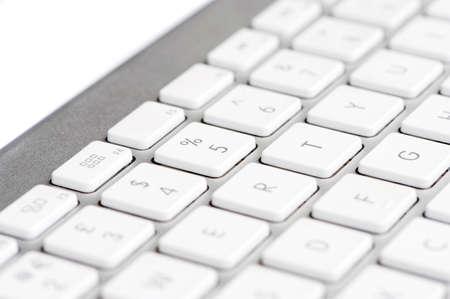 Apple mac white Keyboard focused on the number 5