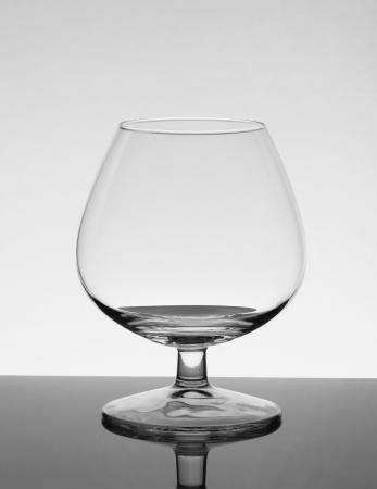 Empty brandy glass with reflection
