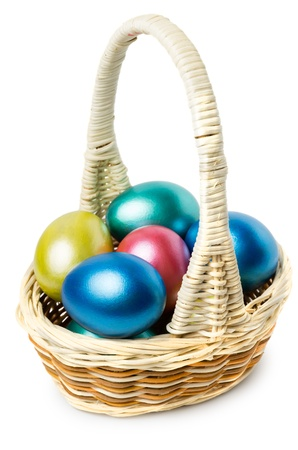 Multi-colored Easter eggs in basket with handle isolated on white background photo