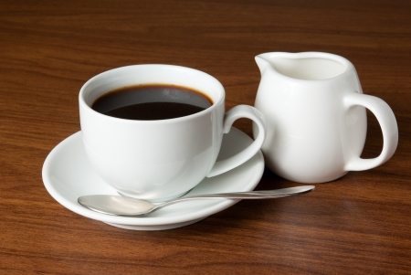 Coffee and milk  on table photo