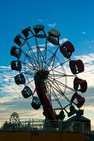 Ferris wheel on background of sunset sky photo