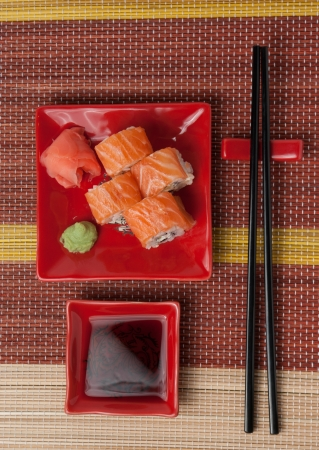 Portion of rolls with soy sauce, ginger, wasabi.Top view Stock Photo - 20634789