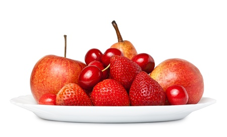 Various fruit on a plate isolated on white background. Side view photo