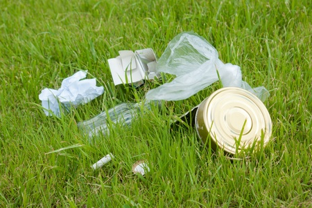 ugliness: Garbage on the green lawn. Environmental pollution
