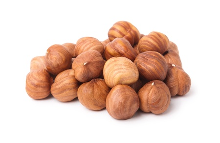 Heap of hazelnuts usolated on white background photo