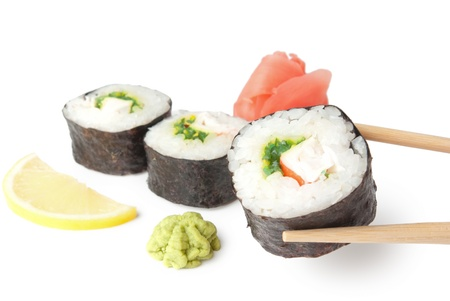 Three sushi, wasabi, gringer, lemon and sticks isolated on white background photo