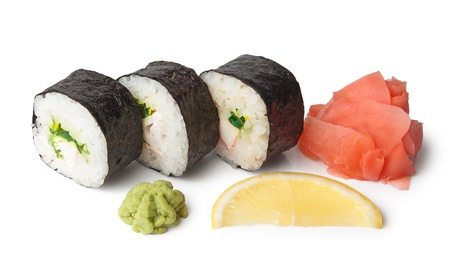 Three sushi, wasabi, gringer and lemon isolated on white background photo