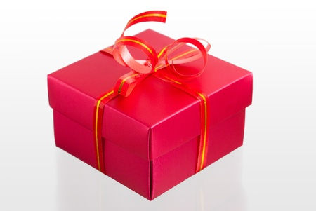 Red box, tied with ribbon photo