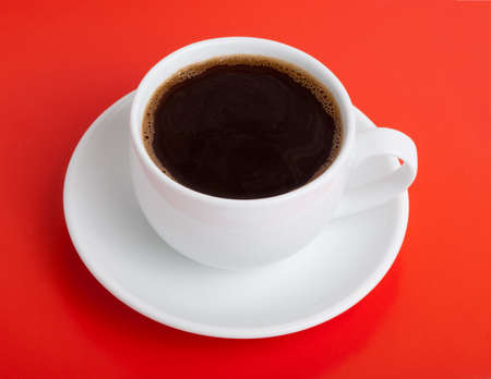 Black coffee on red background photo