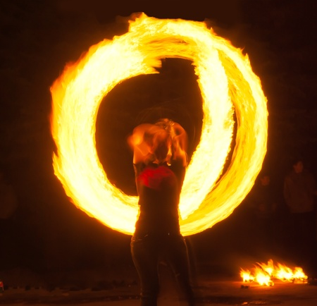 poi: Girl with poi performs fire circle. Fireshow