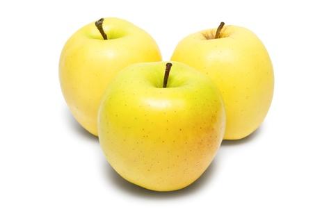 Three yellow apples isolated on white background Archivio Fotografico