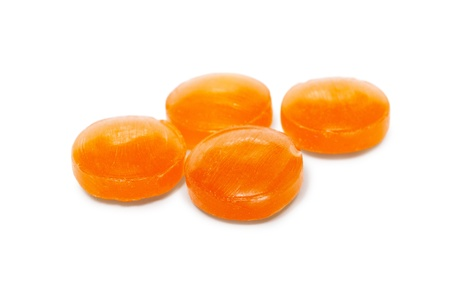 minty: Orange cough drops isolated on white background