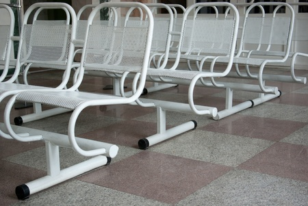 Rows of metal chairs in waiting room Archivio Fotografico