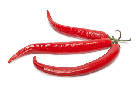 Three hot red peppers on white background photo