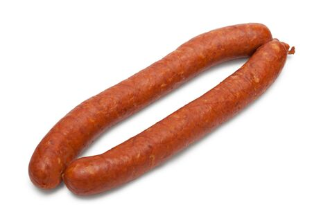 Smoked small sausage isolated on white background