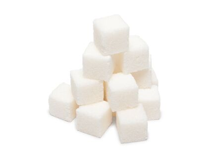 Heap of lumpy sugar isolated on white background photo