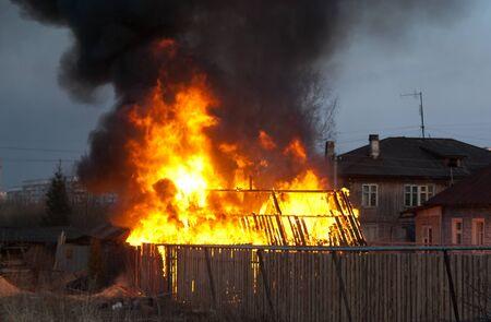 burning building in rural terrain