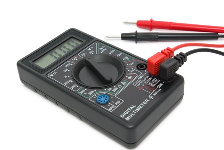 Portable electronic digital multimeter isolated on white background photo