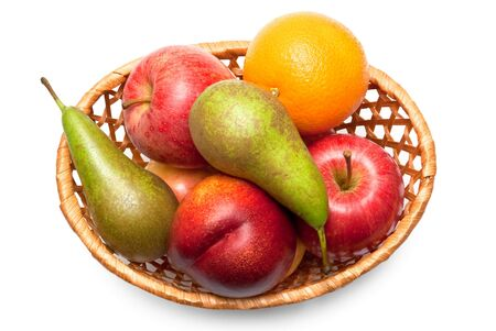 Wicker basket with fruit isolated on white background photo