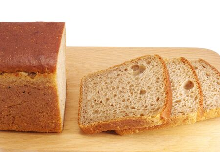 pumpernickel: Cut rye bread on wooden board isolated on white background