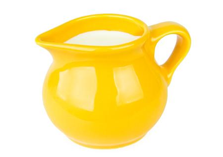Yellow milk jug isolated on white background photo