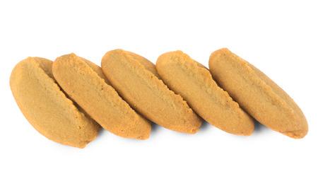 shortbread: Row of shortbread cookies isolated on white background