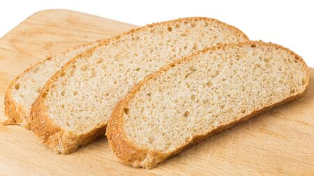 hardboard: Slices of bran bread on wooden board isolated on white background