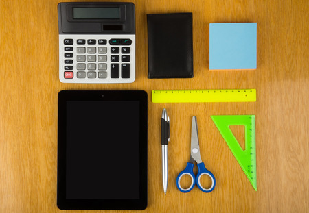 palmtop: Calculator, tablet PC and stationery on table