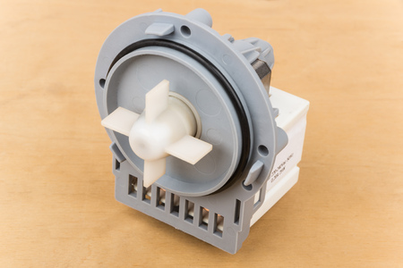 impeller: Faulty electric pump motor washing machine on wooden table