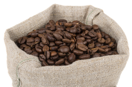 Burlap bag of coffee beans roasted coffee isolated on white background