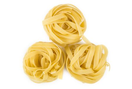 pasta isolated: Pasta in form nest isolated on white background. Top view