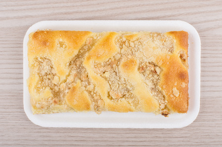 polyfoam: apple pie in polyfoam tray on table, top view Stock Photo