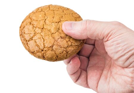 bodyparts: Round cookies in a mans hand isolated on white background Stock Photo