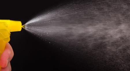 Water spray from sprinkler on black background Stock Photo