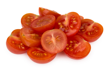 halved: Heap of halved cherry tomatoes isolated on white background Stock Photo